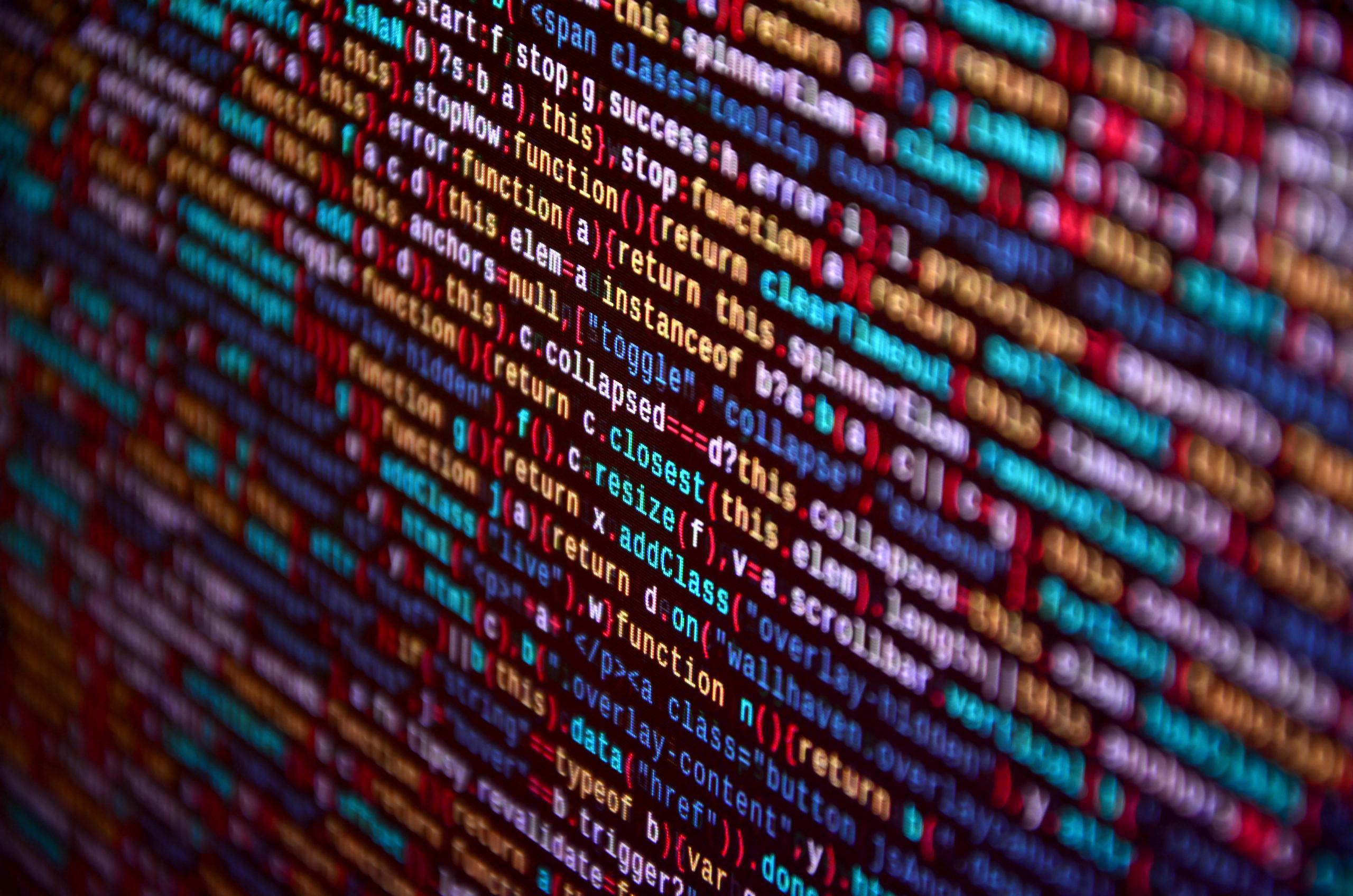 Software developer programming code on computer. Abstract computer script source code